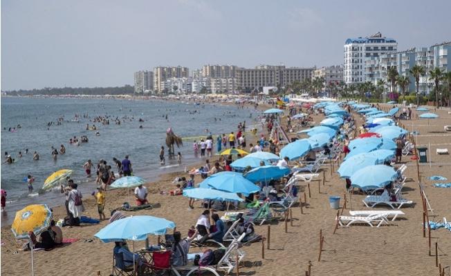 Büyükşehir'in Plajlarına Tatilci Akını