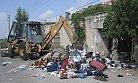 Tarsus'da Bir Evden 2 Kamyon Dolusu Çöp Çıktı.